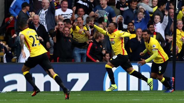 Camilo Zuniga, centre, netted Watford's second goal of the game