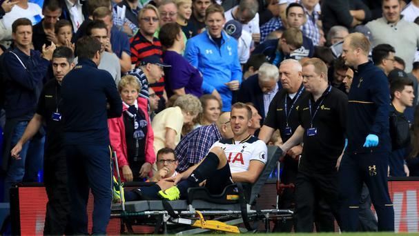 Goalscorer Harry Kane leaves on stretcher