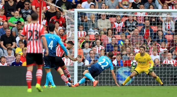 Charlie Austin, centre, scored Southampton's winner against Swansea