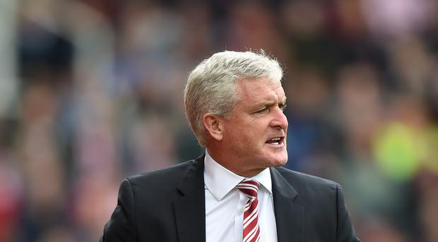 Stoke manager Mark Hughes has been fined by the FA