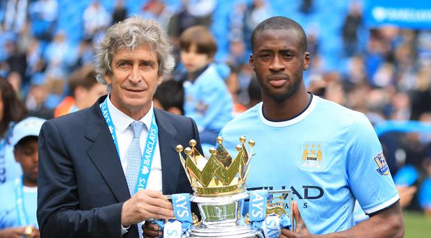 Yaya Toure, right, was an integral part of Manchester City's side under former manager Manuel Pellegrini