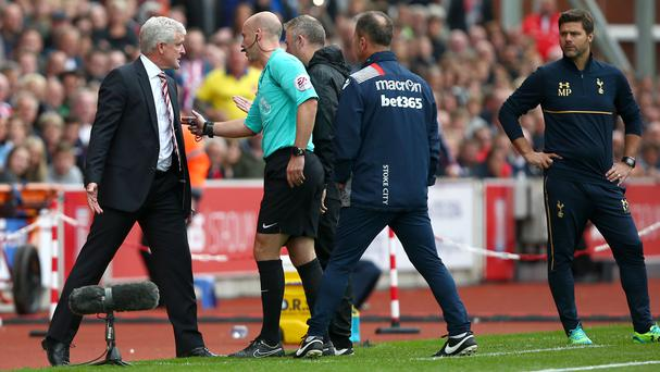 Stoke manager Mark Hughes, left, was fined £8,000 after he accepted the standard punishment following his FA misconduct charge