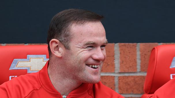 Manchester United's Wayne Rooney was all smiles despite being left on the bench