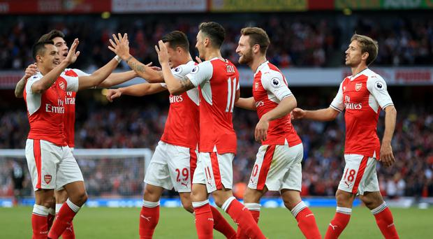 Arsenal's players celebrate against Chelsea