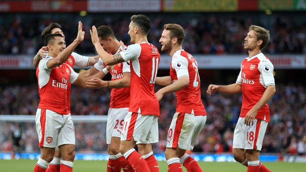 Arsene Wenger was delighted with Arsenal's team performance against Chelsea