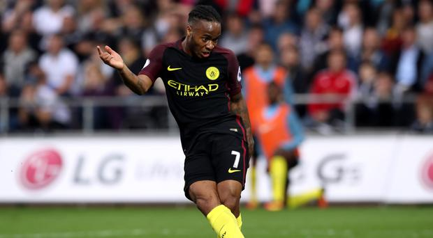 Raheem Sterling, pictured, is enjoying life at Manchester City under manager Pep Guardiola