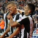 Newcastle striker Dwight Gayle, left, celebrates with Aleksandar Mitrovic after scoring his winning goal against Norwich