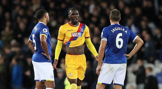 Christian Benteke (centre) exchanges words with Everton's Phil Jagielka (right)