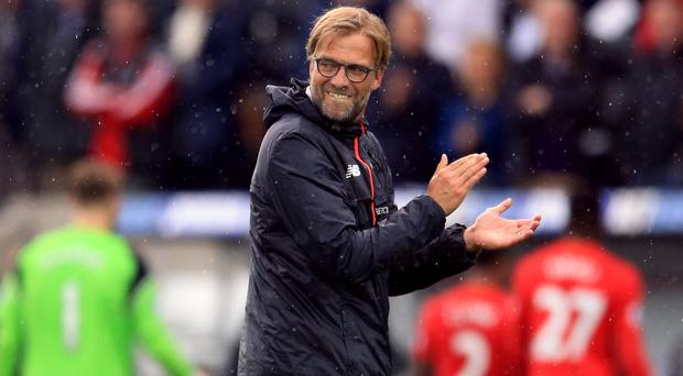 Liverpool manager Jurgen Klopp admitted he was angry after their first-half performance at Swansea