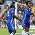 Chelsea's Willian, pictured right, celebrates scoring his side's first goal