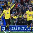 Troy Deeney, left, celebrates after scoring Watford's first goal