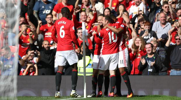 Manchester United's players celebrate Anthony Martial's opener