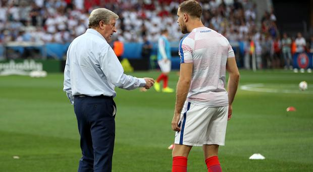 Jordan Henderson, pictured right, in conversation with former England manager Roy Hodgson prior to the Euro 2016 defeat to Iceland