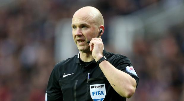 Referee Anthony Taylor will be in the Anfield spotlight