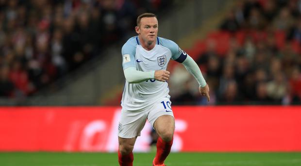 Wayne Rooney (pictured) has been treated unfairly by England fans, according to Bryan Robson