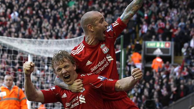 d63e9d307 Liverpool s Dirk Kuyt (left) celebrates his hat-trick against Manchester  United with Raul