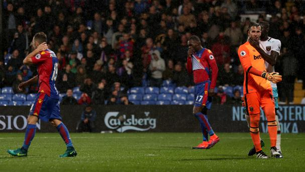Adrian (right) celebrates after Christian Benteke (centre) misses a penalty