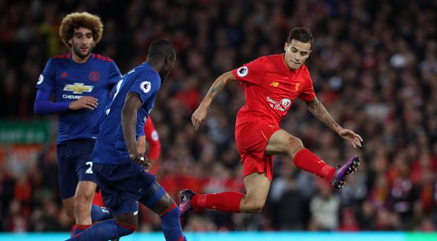 Philippe Coutinho, right, came closest to scoring for Liverpool