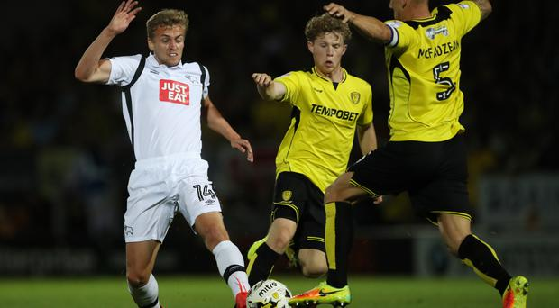 James Wilson, left, has returned to Old Trafford to be assessed