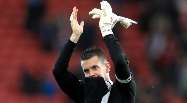 Burnley keeper Tom Heaton, pictured, has been compared with Manchester United's David De Gea