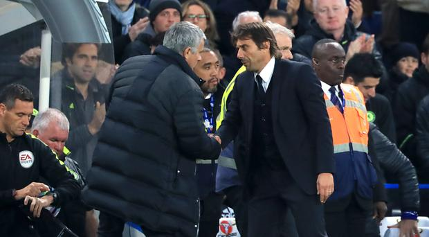 Jose Mourinho, pictured left, had a long chat with Antonio Conte following full-time at Stamford Bridge