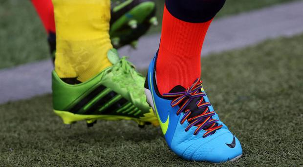 Football clubs lower down the pyramid could benefit from signing an openly gay player, according to a football finance expert