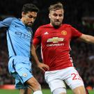 Manchester United's Luke Shaw, right, helped frustrate the Manchester City attack on Wednesday