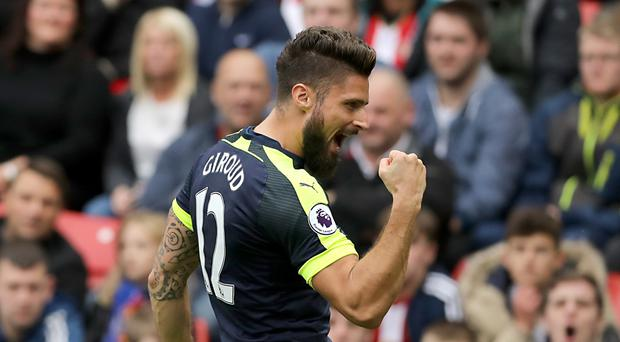Olivier Giroud scored two goals after coming off the bench at the Stadium of Light