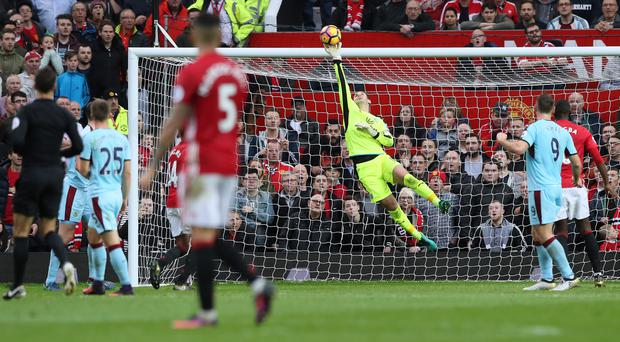 Burnley goalkeeper Tom Heaton impressed to help his team earn a point at Manchester United