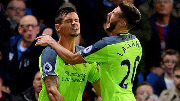 Liverpool's Dejan Lovren, left, scored their second goal after contributing to them conceding their first