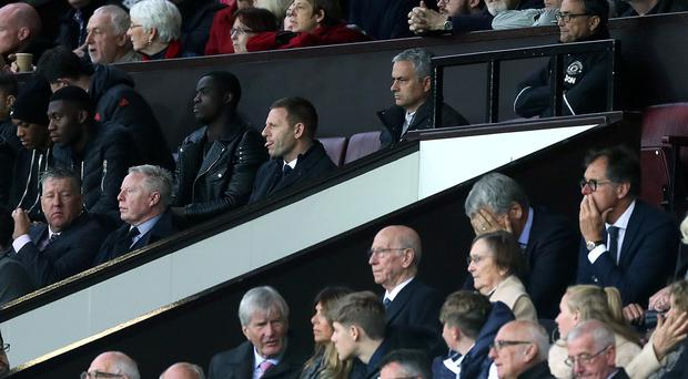 Jose Mourinho, centre top, spent the second half in the directors' box against Burnley