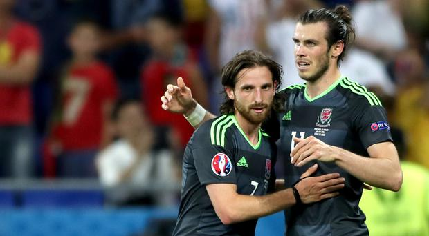 Joe Allen, left, believes some of Gareth Bale's magic has rubbed off on him