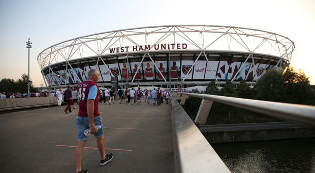 Damian Collins is unhappy at the rising cost of the London Stadium