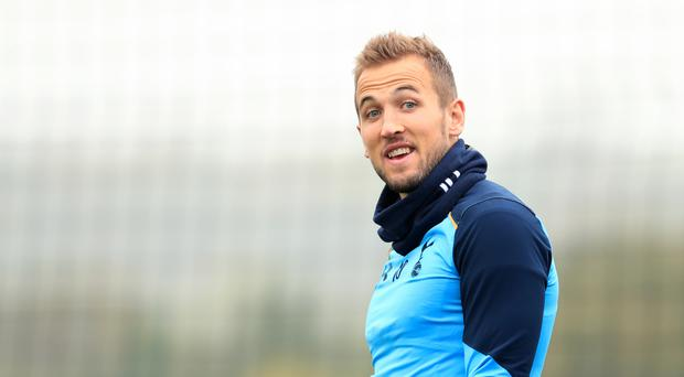 Tottenham's Harry Kane is back in training and could feature against Arsenal