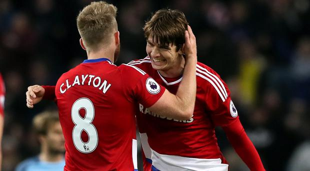Marten de Roon, right, celebrates his late goal