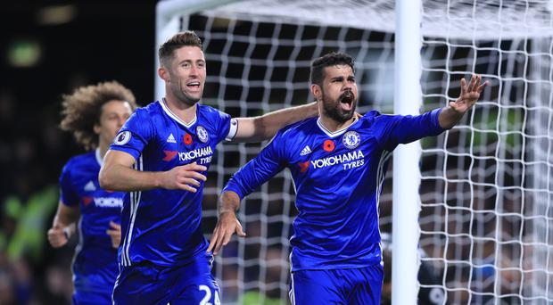 Chelsea's Diego Costa (right) celebrates as he scores his ninth goal of the season