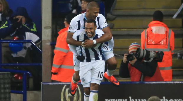 West Brom's Matt Phillips (bottom) celebrates his winner with Salomon Rondon in their 2-1 victory at Leicester