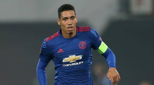 Manchester United's Chris Smalling is reported to be facing at least a month out