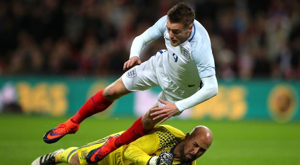 Leicester striker Jamie Vardy won a penalty and scored in England's 2-2 draw with Spain