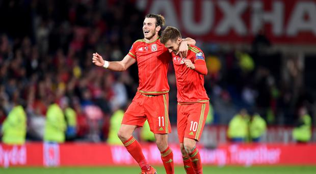Real Madrid are reportedly keen to unite Wales team-mates Gareth Bale (left) and Aaron Ramsey at the Bernabeu