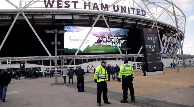 Two men have received football banning orders after trouble during the West Ham v Chelsea match at the London Stadium