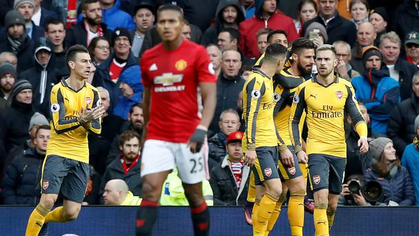 Olivier Giroud, second from right, silenced Old Trafford