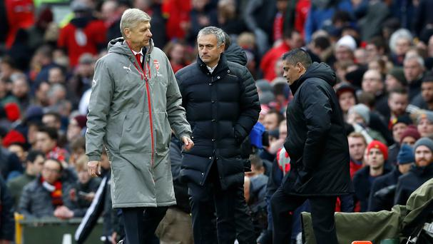 Arsene Wenger, left, and Jose Mourinho saw their teams draw 1-1 at Old Trafford
