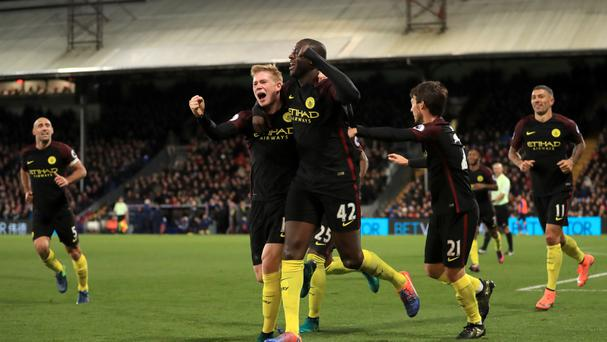 Manchester City's Yaya Toure scored twice as his team won 2-1 at Crystal Palace