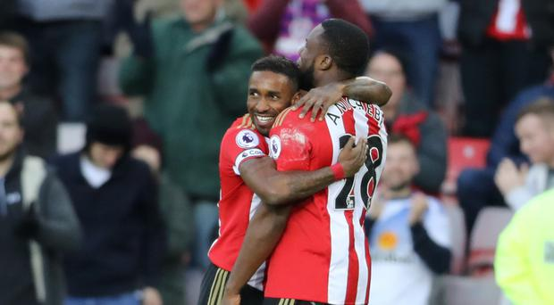 Sunderland's Jermain Defoe (left) celebrates scoring his side's first goal with team-mate Victor Anichebe