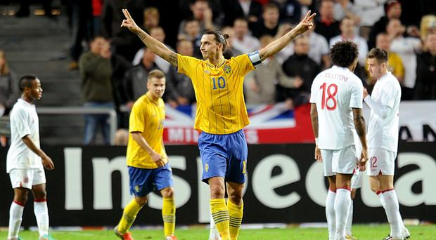 Zlatan Ibrahimovic celebrates his hat-trick against England four years ago