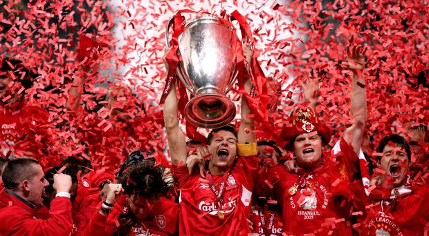 Steven Gerrard, centre has retired from professional football