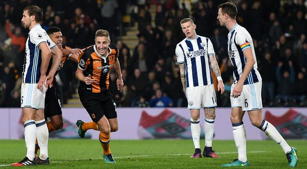 Hull's Michael Dawson, centre, earned a 1-1 draw