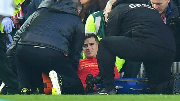 Liverpool manager Jurgen Klopp remains optimistic about Philippe Coutinho's, pictured, ankle injury