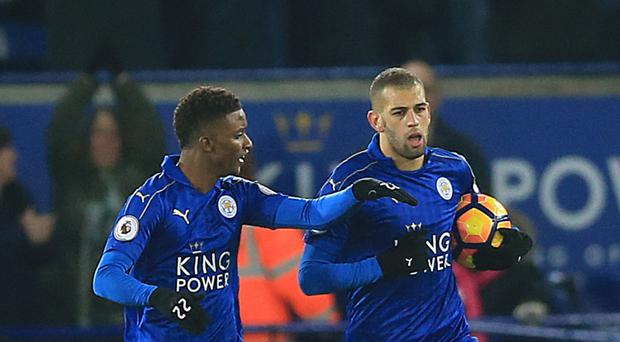 Leicester's Islam Slimani rescued a point with an injury-time penalty in their 2-2 draw with Middlesbrough on Saturday.